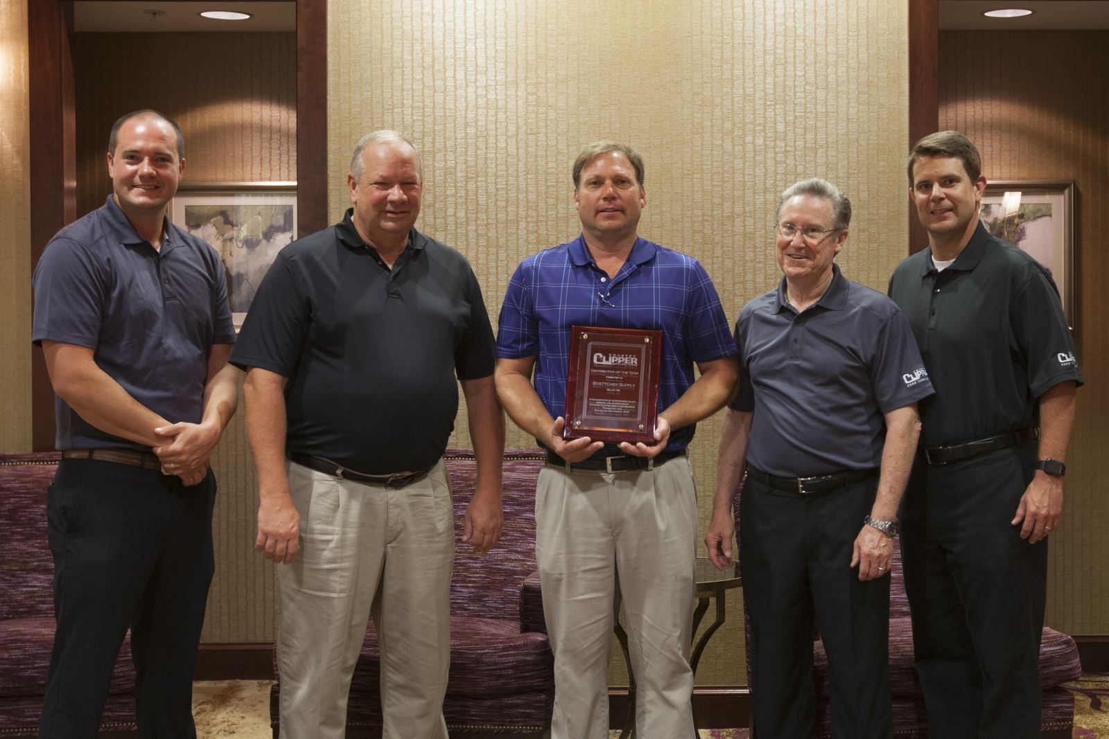 COUNTRY CLIPPER PRESENTS DISTRIBUTOR OF THE YEAR AWARD TO BOETTCHER SUPPLY