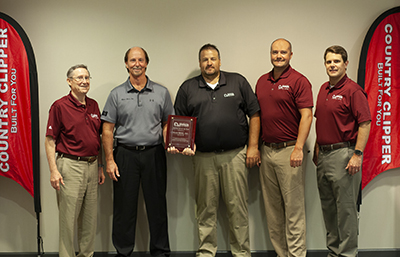 COUNTRY CLIPPER PRESENTS DISTRIBUTOR OF THE YEAR AWARD TO MARR BROS., INC.